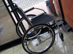 Image of a wheelchair. Section 503 encourages federal contractors to hire IWD's
