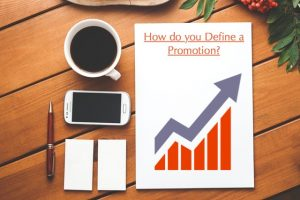 "Image of note papers with a graph pointing up. Text, ""How do you define a promotion?"""