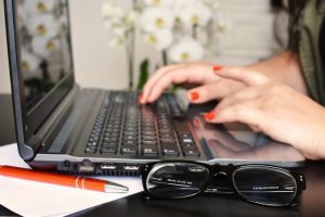 Woman on a keyboard. OFCCP continues to focus on steering issues for women and minorities