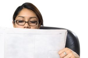 Asian woman looking at a newspaper- affirmative action program