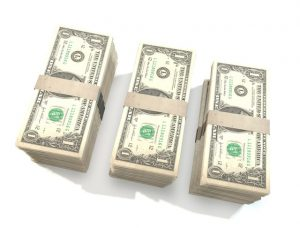 Stacks of dollar bills to symbolize the costs of turnover. affirmative-action-consulting