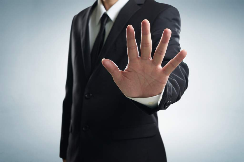 Hand stop shown by businessman