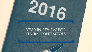 "image of a book and a pen with text, ""2016 year in review for federal contractors"""